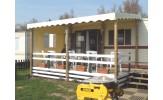 Toiture ivoire avec retombées ondulées pour terrasse de mobil home