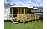 Grande terrasse avec toiture ivoire à vagues pour terrasse de mobil home